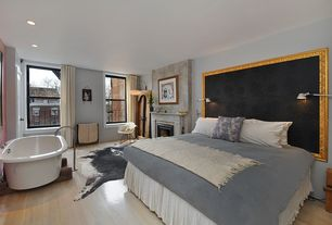 Contemporary Master Bedroom with Maple - Winter Neutral 4 in. Solid Hardwood Plank, Laminate floors, metal fireplace