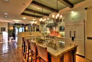 Eclectic Kitchen with mexican tile backsplash, Exposed beam, terracotta tile floors, Inset cabinets, Breakfast bar, L-shaped