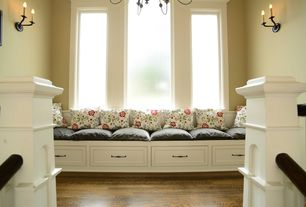 Traditional Hallway with Window seat, Hardwood floors, Columns, Chandelier, picture window, Standard height, Wall sconce