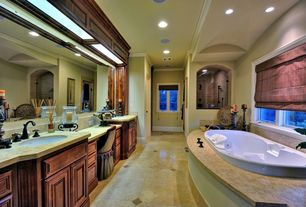 Mediterranean Master Bathroom with Crown molding, Khall pomegranate diffuser, Undermount sink, frameless showerdoor