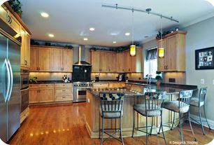 Contemporary Kitchen with gas range, full backsplash, double wall oven, Crown molding, Built In Refrigerator, Wall Hood