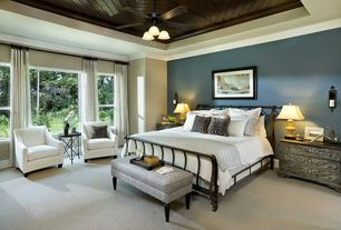Traditional Master Bedroom with Standard height, Crown molding, picture window, Ceiling fan, double-hung window, Carpet