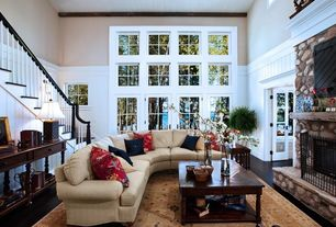 Cottage Living Room with Klaussner - canyon sectional, stone fireplace, picture window, Paint, High ceiling, French doors