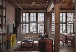 Eclectic Great Room with Built-in bookshelf, Ceiling fan, Columns, flush light, double-hung window, Exposed beam
