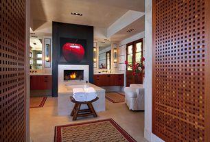 "Traditional Master Bathroom with Rectangular White 66"" Undermount Soaking Bathtub, Wall sconce, Limestone, Glass panel door"