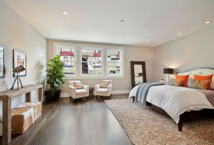 Contemporary Master Bedroom with can lights, Hardwood floors, Standard height, double-hung window