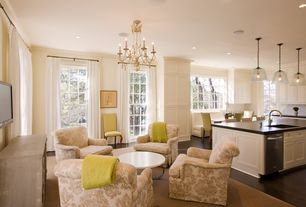 Traditional Great Room with Casement, Standard height, French doors, Hardwood floors, Pendant light, can lights, Chandelier