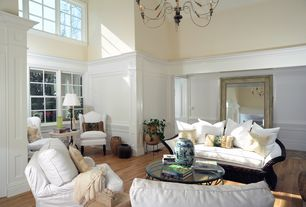 Traditional Living Room with Hardwood floors, Casement, High ceiling, Box ceiling, Chandelier, double-hung window