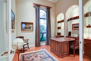 Traditional Home Office with Crown molding, Hardwood floors, Built-in bookshelf, French doors, Arched window, High ceiling