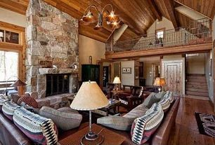 Rustic Great Room with Exposed beam, Hardwood floors, Loft, Transom window, Fireplace, French doors, Chandelier, Wall sconce