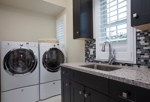 Traditional Laundry Room with double-hung window, High ceiling, Undermount sink, limestone floors, laundry sink