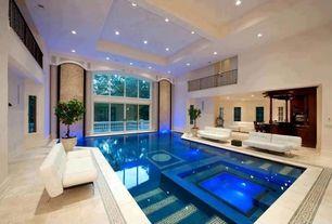 Mediterranean Swimming Pool with exterior tile floors, Deck Railing, picture window, Indoor pool, sliding glass door