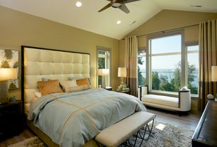 Traditional Master Bedroom with Hardwood floors, Ceiling fan, Built-in bookshelf, Window seat