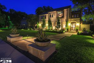 Traditional Landscape/Yard with Arched window, Pathway, French doors, Agave Desmettiana Variegata, exterior stone floors