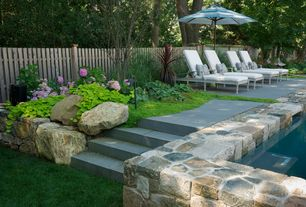 Traditional Landscape/Yard with Outdoor lounge furniture, exterior stone floors, Pathway, Raised beds, Fence
