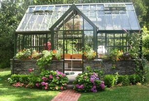 Traditional Landscape/Yard with Greenhouse, Brick pathway, Skylight, Pathway, Raised beds, Garden Conservatory