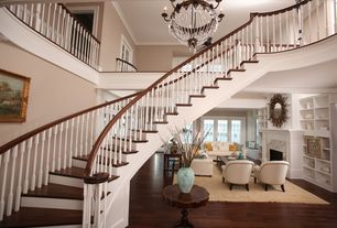 Traditional Staircase with High ceiling, curved staircase, Hardwood floors, Loft