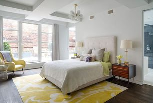 Contemporary Master Bedroom with Chandelier, Hardwood floors, Exposed beam, West elm diamond tufted headboard, High ceiling