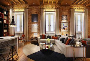 Contemporary Great Room with Built-in bookshelf, Exposed beam, Standard height, Hardwood floors, Pendant light, Casement