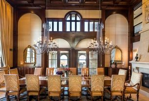 Traditional Dining Room with Loft, Arched window, Crown molding, Cement fireplace, French doors, Chandelier, Box ceiling