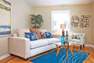 Modern Living Room with Arteriors home gwenieve coffee table, Standard height, Hardwood floors, double-hung window