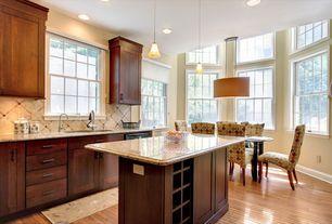Traditional Kitchen with can lights, Kitchen island, Pendant light, full backsplash, High ceiling, Undermount sink, Flush