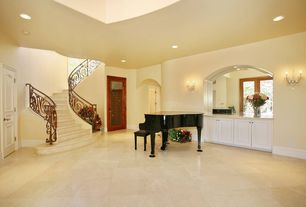 Mediterranean Staircase with can lights, flush light, six panel door, curved staircase, stone tile floors, High ceiling