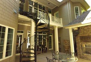 Traditional Staircase with Crown molding, Concrete floors, Spiral staircase, High ceiling, French doors