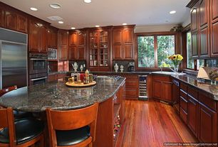 Traditional Kitchen with Hardwood floors, Standard height, built-in microwave, Marble countertop, partial backsplash