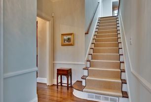 Traditional Staircase with Laminate floors, High ceiling, Wainscotting