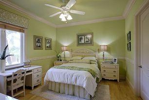 Country Guest Bedroom with Ceiling fan, Hardwood floors, Chair rail, Standard height, Crown molding, Casement, six panel door