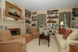 Traditional Living Room with brick fireplace, double-hung window, Carpet, Fireplace, Standard height, Built-in bookshelf