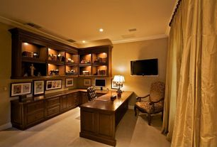 Traditional Home Office with Crown molding, can lights, Built-in bookshelf, Carpet, Standard height