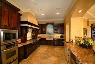 Traditional Kitchen with Undermount sink, High ceiling, Arched window, Custom hood, Farmhouse sink, U-shaped, Crown molding