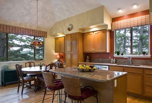 Country Kitchen with Kitchen island, Simple granite counters, Flat panel cabinets, Pental african ivory polished granite