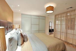 Contemporary Guest Bedroom with Stained glass window, Hardwood floors, Carpet, Pendant light