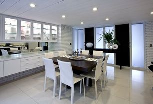 Contemporary Dining Room with stone tile floors, Glass panel door, French doors, can lights, interior brick, Standard height