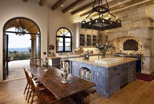 Mediterranean Kitchen with High ceiling, L-shaped, Custom hood, Covered patio, Chandelier, French doors, Farmhouse sink