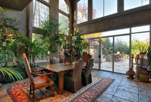 Eclectic Dining Room with French doors, Transom window, Arched window, Cathedral ceiling, Carpet