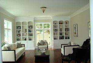 Contemporary Living Room with Laminate floors, Pendant light, Wainscotting, Standard height, Crown molding, French doors