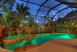 Tropical Swimming Pool with exterior stone floors, Poured concrete floors, Covered pool, Pool with hot tub, Gate