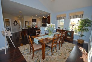 Contemporary Dining Room with Hardwood floors, double-hung window, High ceiling