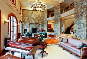 Traditional Living Room with High ceiling, Hardwood floors, Crown molding, Sunken living room, Wall sconce, Fireplace, Loft