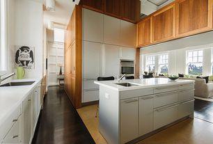 Contemporary Kitchen with limestone tile floors, Galley, flush light, Kitchen island, Undermount sink, Corian counters, Flush