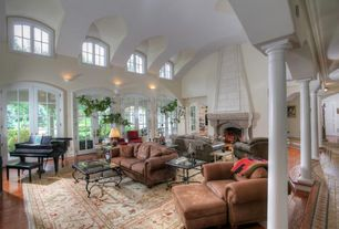 Mediterranean Living Room with Hardwood floors, Arched window, French doors, High ceiling, Wall sconce, Columns