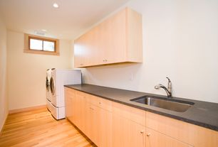 Contemporary Laundry Room with Built-in bookshelf, Undermount sink, Laminate floors