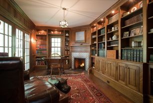 Traditional Home Office with Pendant light, can lights, bedroom reading light, Fireplace, stone fireplace, Built-in bookshelf