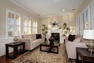 Traditional Living Room with Hardwood floors, Casement, Delia Cream Navy Area Rug, Standard height, Wainscotting, can lights