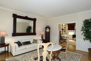 Traditional Living Room with Crown molding, Wainscotting, Standard height, Hardwood floors