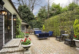 Traditional Patio with Fence, exterior stone floors, Outdoor kitchen, Glass panel door